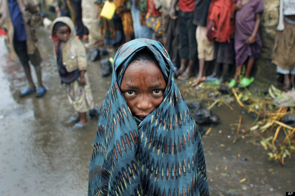 Drenched-Congolese-child-Kibati-north-of-Goma-eastern-Congo-080812-by-Jerome-Delay-AP[1]