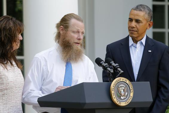 U.S. President Obama watches as the parents of U.S. Army Sergeant Bergdahl talk about the release of their son at the White House in Washington